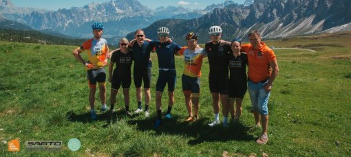 Group of cyclists in the Dolomites Italy | HC Bike Tours team with our guests from the USA