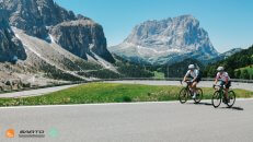 Our guests from the USA cycling Pordoi Pass in the Dolomites Italian Alps