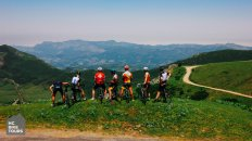 HC Bike Tours organized bike tour in Cantabria Spain | A group of our guests at the top of Lagos de Covadonga climb